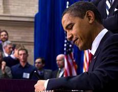 Obama signs Recovery Act 2009