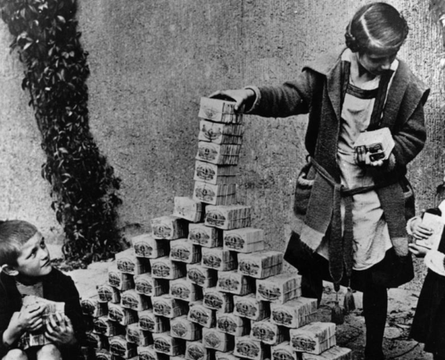 German children playing with worthless money